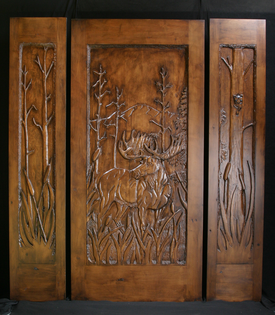 Wooden doors hand carved wooden doors montana for Custom made wood doors